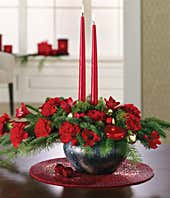 Large Christmas centerpiece with flowers and red candles