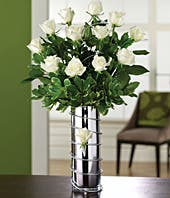 One dozen white roses in silver vase