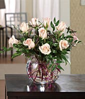 Pink roses delivered in a glass bubble vase by florist