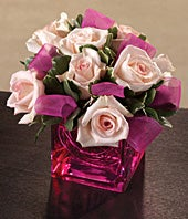Pink roses with ribbon in pink square vase
