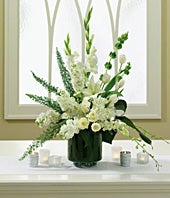 Wedding altar arrangement of white tulips and orchids