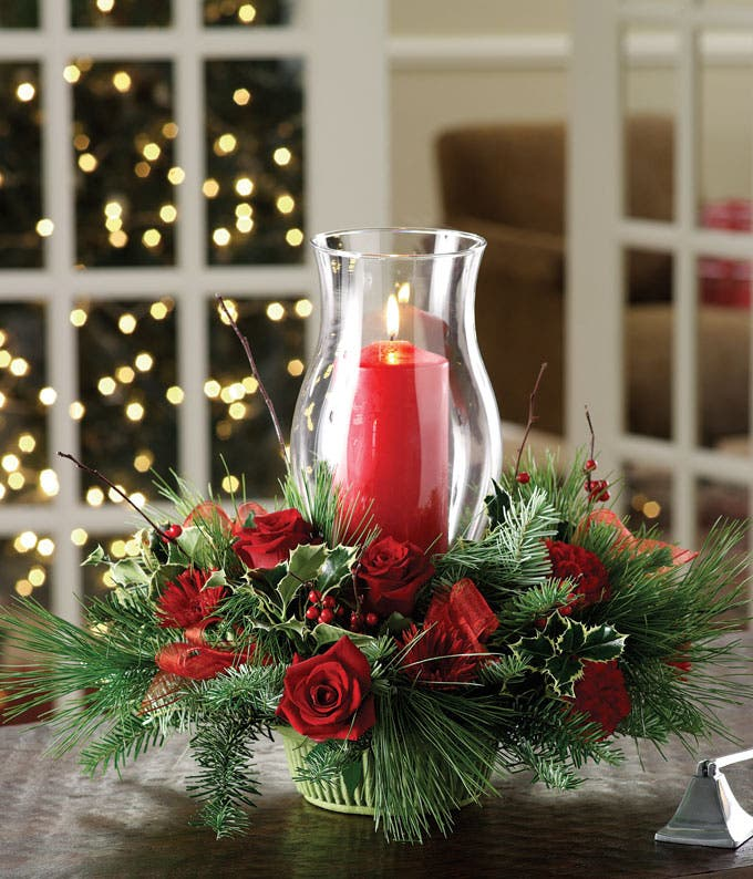 Holiday Centerpiece with red flowers and candle