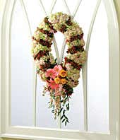 Floral wreath with hydrangea, hypericum and daisies
