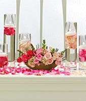 Pink roses and snapdragons in a centerpiece