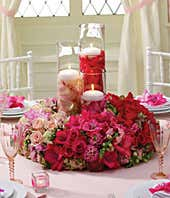 Flower centerpiece with roses, snapdragons and hydrangea