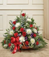 Red, blue and white flower sympathy basket