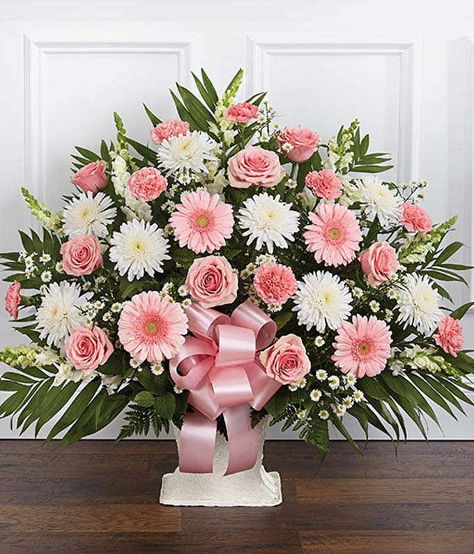 Pink & white sympathy floor basket with pink roses and white flowers