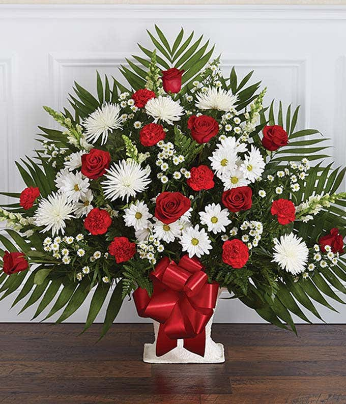Red roses and white flower sympathy floor basket