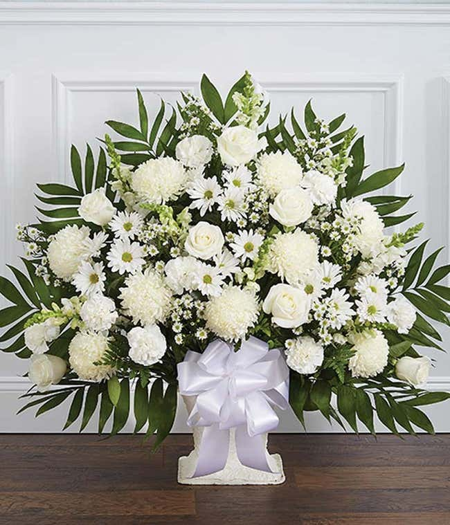 White sympathy basket with white roses and spider mums