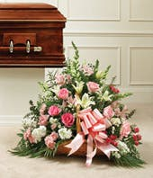 Pink roses, white roses and carnation fireside basket