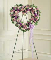 Heart shaped standing spray with purple and white flowers