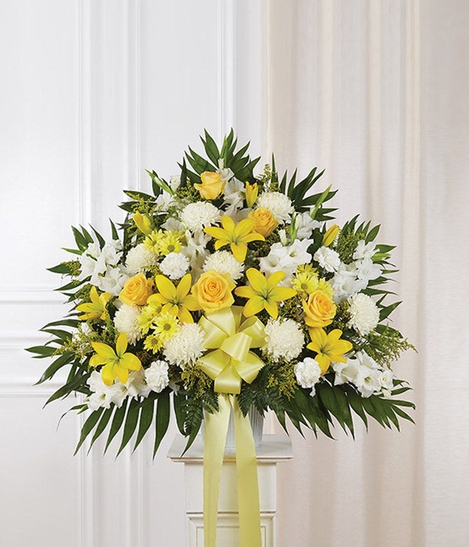 Yellow & white rose and lily sympathy standing basket