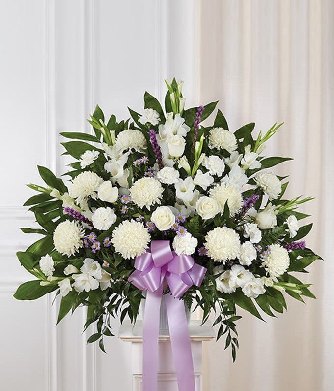Sympathy basket with purple and white flowers