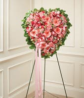 Pink roses, pink lilies and pink gerbera daisies in heart standing spray