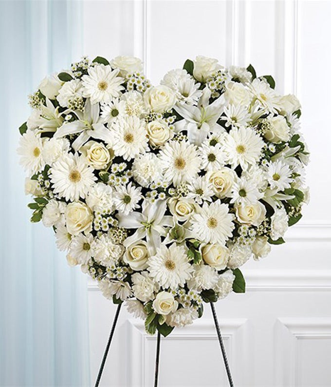 White roses, white lilies and white daisies in heart standing spray