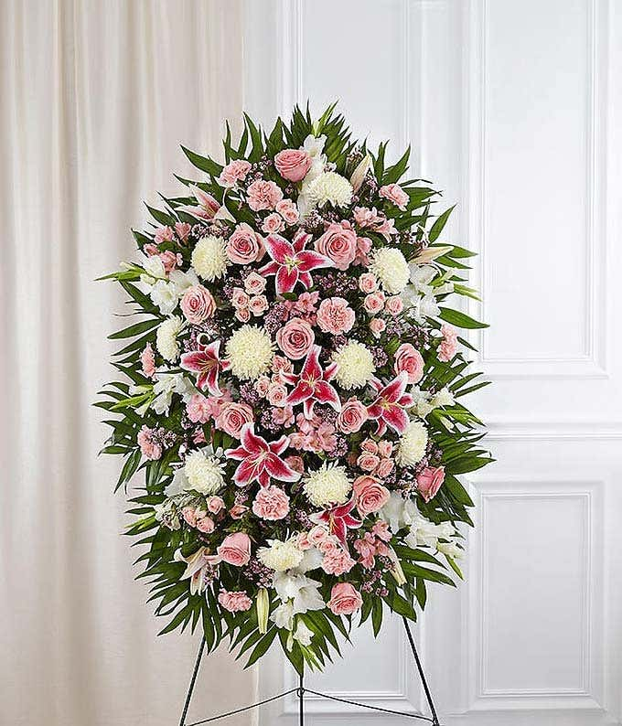 Pink roses, pink lilies and white mums in standing spray