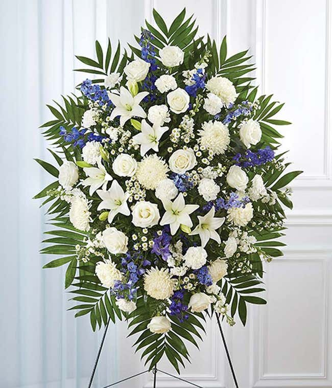 Blue delphinium and white flower standing spray
