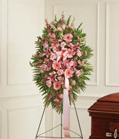 Pink sympathy standing spray with roses and stargazer lilies