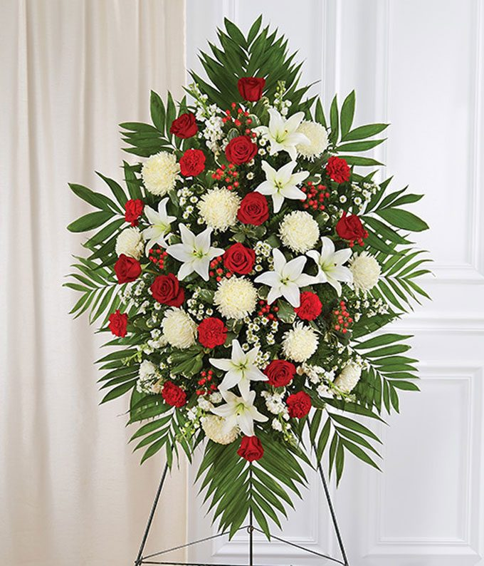 Funeral spray with red roses and carnations