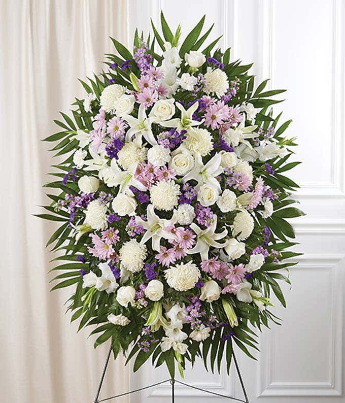 Lavender & white standing sympathy spray with roses