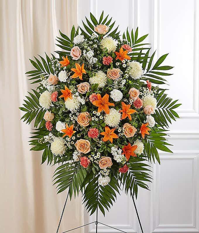 Orange roses and white spider mum funeral standing spray