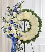 Blue flowers and white flowers standing sympathy wreath