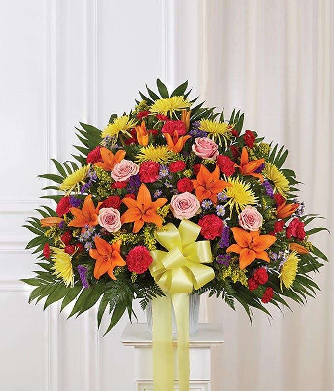 Multicolor flower sympathy standing basket