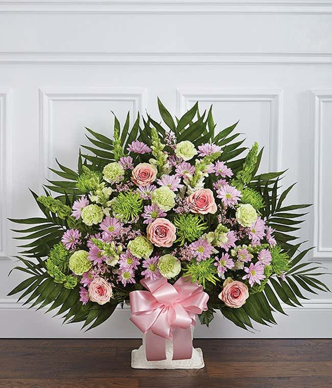 Pink and green snapdragons and gladioloas sympathy basket