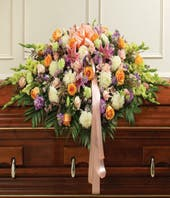 Mixed color and floral stem casket spray