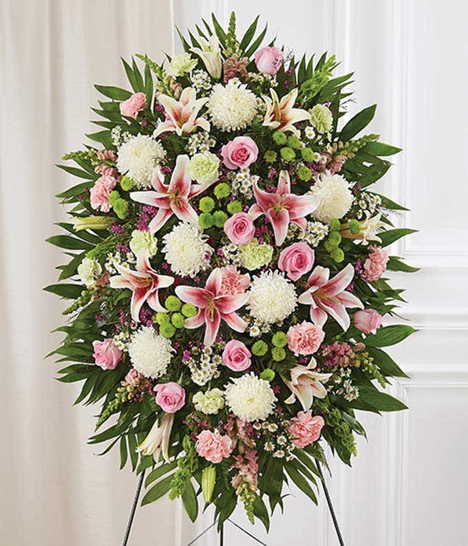 Floral pastel sympathy standing spray with roses and lilies
