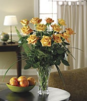 Long stemmed one dozen orange roses in crystal vase