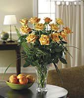 Long stemmed one dozen orange roses in crystal vase