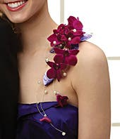 Purple orchid corsage that sits on the shoulder
