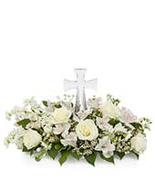 White sympathy flowers with Cross at center