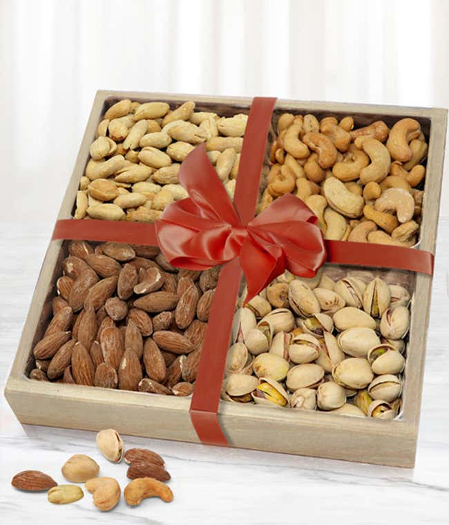 Variety of nuts in wooden tray