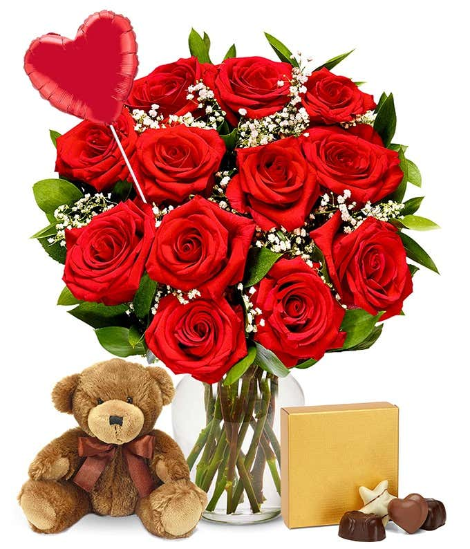One dozen red roses delivered with heart balloon, teddy bear and chocolates
