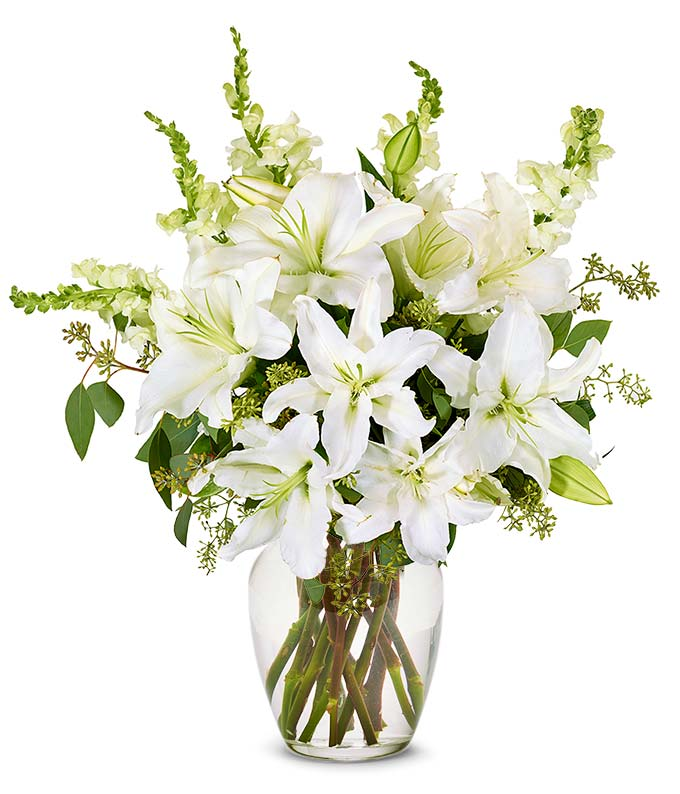 White snapdragons and white lily bouquet