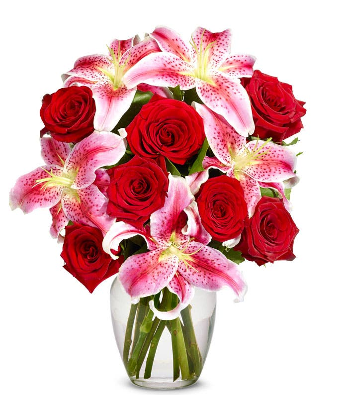 Red roses arranged with pink stargazer lilies