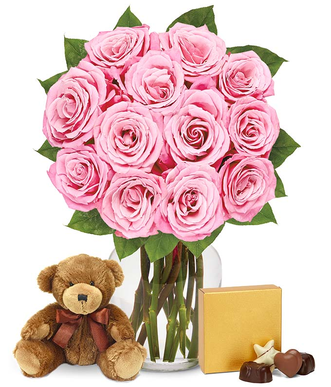 One dozen pink roses, teddy bear and box of chocolates