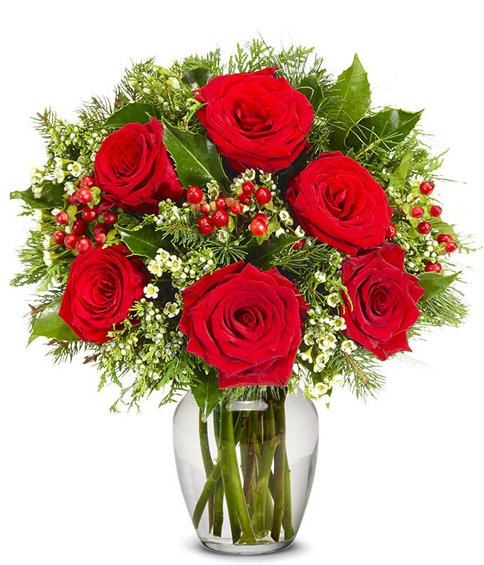 Red roses with red hypericum berries