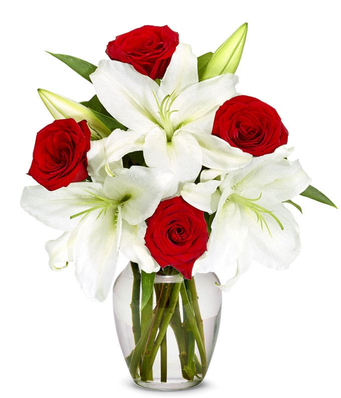 White Asiatic Lilies arranged with red roses