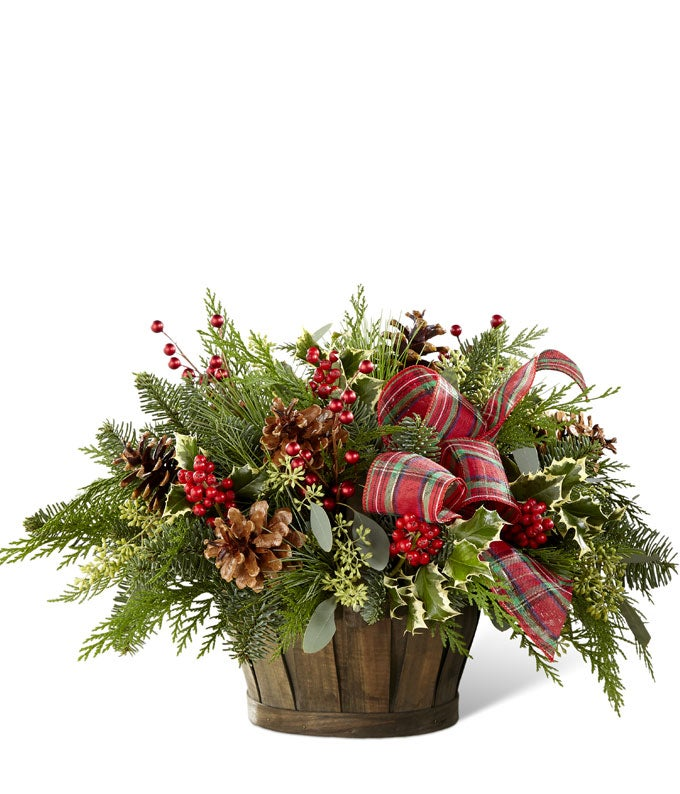 Christmas greens arranged with holly in a basket