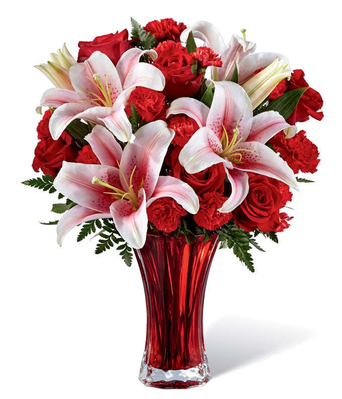 Love flowers with red roses, red carnations and pink lilies