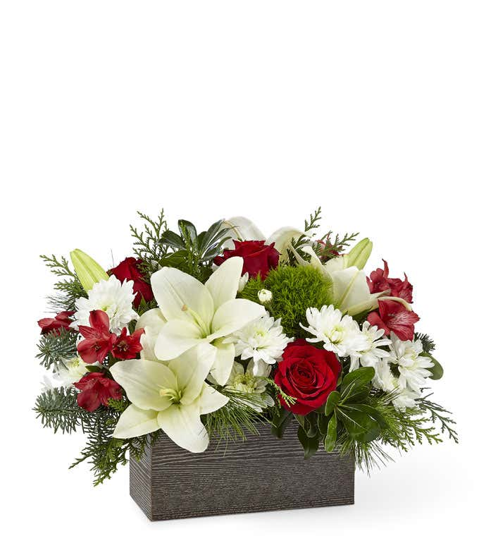 White lilies, red roses and red alstroemeria in a rectangle box.