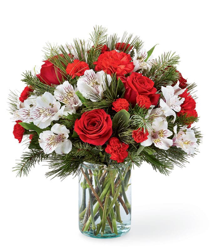 Holiday flowers and evergreen bouquet