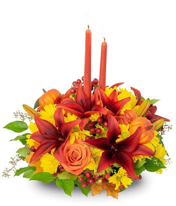 Pumpkin candle flower centerpiece