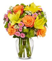 Yellow lilies, orange roses and pink matsumoto bouquet