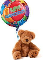 Happy anniversary balloon delivered with teddy bear