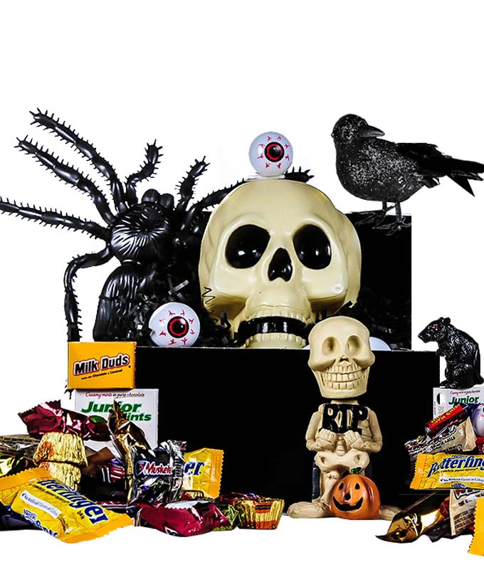 Halloween candy and halloween themed toys basket