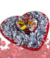 Heart shaped chocolate basket with Hershey kisses and mini candy bars